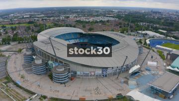 Drone shot Orbiting High Up Around Manchester City's Etihad Stadium, UK