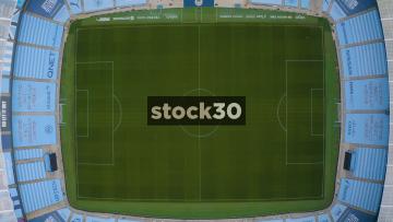 Rotating Drone Shot Over Pitch Of Manchester City's Etihad Stadium, UK