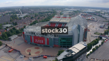 Drone Shot Orbiting Clockwise Around Manchester United's Old Trafford Football Stadium, UK