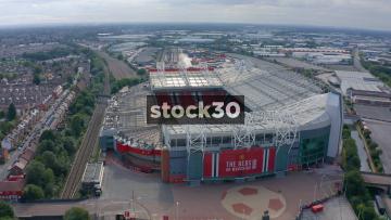 Drone Shot Orbiting Anticlockwise Around Manchester United's Old Trafford Football Stadium, UK