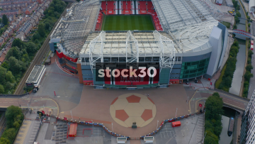 Drone Shot Flying Over The Pitch Of Manchester United's Old Trafford Football Stadium, UK