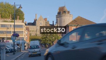 Wide Shot Of Windsor Castle With Passing People And Traffic, UK