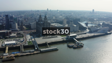 Drone Shot Over The River Mersey In Liverpool, Approaching The Liver Building, UK
