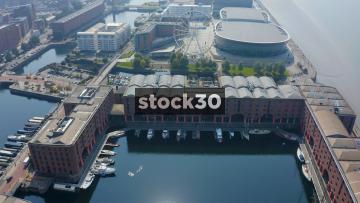 Drone Shot Flying Over The Albert Dock And Ferris Wheel In Liverpool, UK