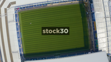 Rotating Drone Shot Over Pitch Of Everton's Goodison Park Football Stadium In Liverpool, UK