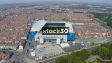 High Drone Shot Orbiting Anticlockwise Around Everton's Goodison Park Football Stadium In Liverpool, UK