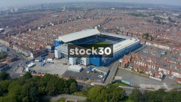 High Drone Shot Orbiting Clockwise Around Everton's Goodison Park Football Stadium In Liverpool, UK