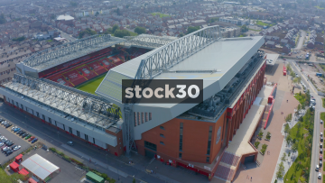 Close Up Drone Shot Orbiting Anticlockwise Around The Front Of Anfield Football Stadium In Liverpool, UK