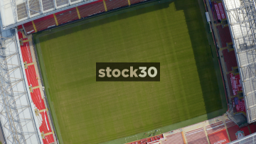 Rotating Drone Shot Over The Pitch Of Anfield Football Stadium In Liverpool, UK