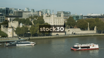 The Tower Of London With Boats Passing By, UK
