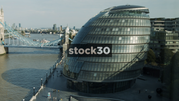 City Hall Building In London, Panning Shot With Tower Bridge, UK