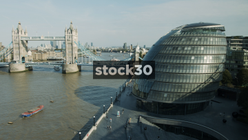 City Hall Building In London, Wide Panning Shot With Tower Bridge, UK