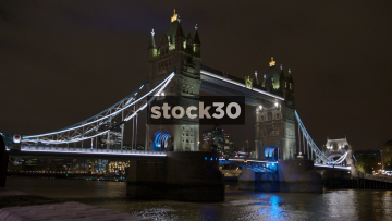Close Up Angle Of Tower Bridge In London At Night With Gherkin Building In Background, UK