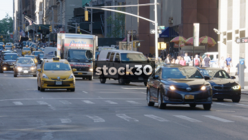 Busy New York Street With Traffic And Yellow Taxis, USA