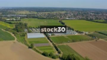 Drone Shot Flying High Above Farm Land, UK