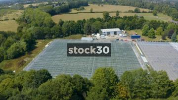 Rotating Clockwise Drone Shot Of Large Greenhouses On Farm, UK