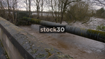 River Mersey Almost Flooding With Very High Water Level At Flixton Bridge, Manchester, UK