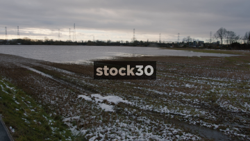 Panning Shot Of Flooded Fields By River Mersey In Flixton, Manchester, UK