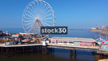 Panning Drone Shot of Ferris Wheel On Central Pier In Blackpool, UK