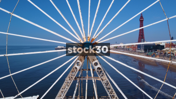 Drone Shot Moving Backwards Away From Ferris Wheel On Central Pier In Blackpool, UK
