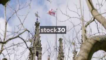 Slow Motion Shot Of The St George Flag On Top Of St Mary's Church In Warwick, UK