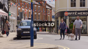 Market Place In Warwick With Passing People And Traffic, UK