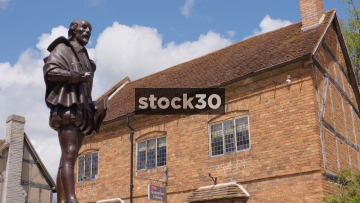 Statue Of William Shakespeare And Shakespeare Gift Shop In Stratford, UK