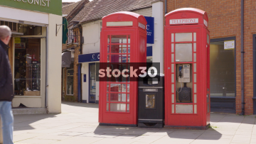 Two Classic Red British Telephone Boxes In Stratford, UK
