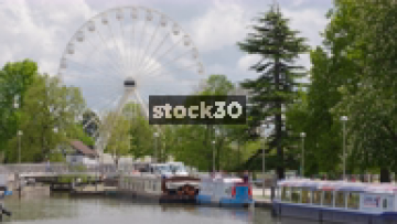 Canal Area With Boats And Ferris Wheel In Stratford, UK