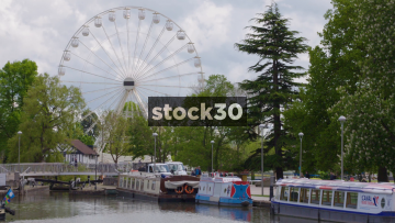 Timelapse Shot Of Canal Area With Boats And Ferris Wheel In Stratford, UK