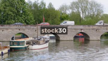 Traffic Crossing Bridge Over The River Avon In Stratford, UK