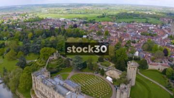 Drone Shot Flying Backwards Over Warwick Castle, UK