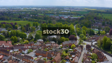 Drone Shot Flying Over Houses And St Nicholas Church In Warwick, UK