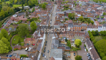 Drone Shot Flying Over Houses And Road In Warwick, UK