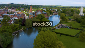 Drone Shot Flying Down The River Avon Towards The RSC Theatre In Stratford, UK