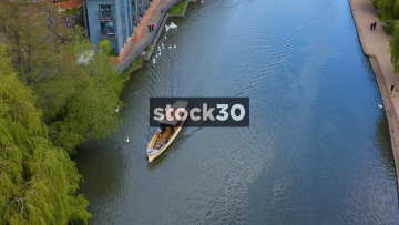 Drone Shot Of Cruise Boat Travelling Down The River Avon In Stratford, UK