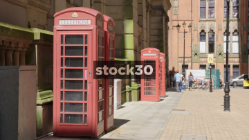 Classic Red British Telephone Boxes In Birmingham, UK