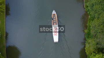 Ascending Overhead Drone Shot Of Cruise Boat Travelling Down The River Avon In Stratford, UK