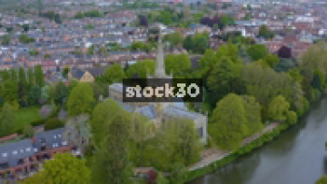 Drone Shot Rotating Anticlockwise Around Church On The Banks Of The River Avon In Stratford, UK