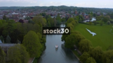 High Drone Shot Following Cruise Boat Down The River Avon In Stratford, UK