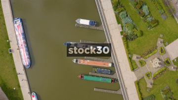 Rotating Overhead Drone Shot Of Boats Moored On The River Avon In Stratford, UK