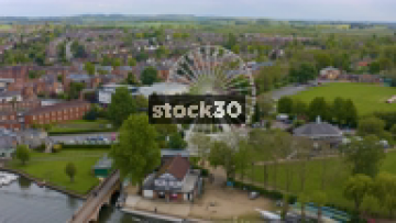 Drone Shot Of Ferris Wheel By The River Avon In Stratford, UK