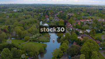 Wide Drone Shot Of Cruise Boat Travelling Down The River Avon In Stratford, UK
