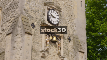 Clock On The Carfax Tower In Oxford Chiming, UK