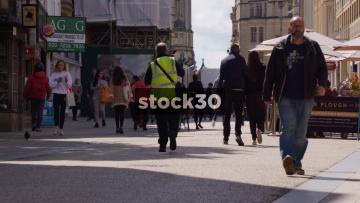 Slow Motion Shot Of People Walking Down Cornmarket Street In Oxford, UK