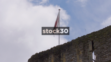 Slow Motion Shot Of Flag Of St George Flying On Top Of Oxford Castle And Prison, UK