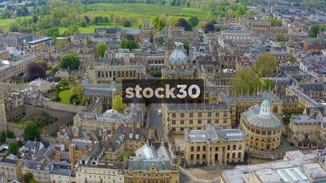 Drone Shot Flying Backwards Over Historic Buildings In Oxford City Centre, UK