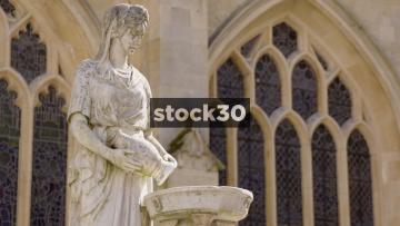 Statue Of Woman Pouring Water Outside Bath Abbey, Bath, UK