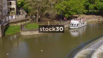 Panning Shot Of River Avon In Bath, With William Pulteney Cruise Boat, UK