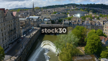 Drone Shot Flying Over River Avon And William Pulteney Bridge In Bath, UK